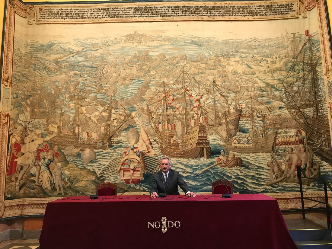 Robert Kennedy Jr. in front of a tapestry memorializing Charles V's Spanish conquest of Tunisia. May 2017